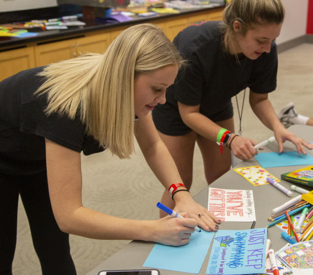 Team Members attending the Dance Marathon make cards for kids at Nationwide Children's Hospital.