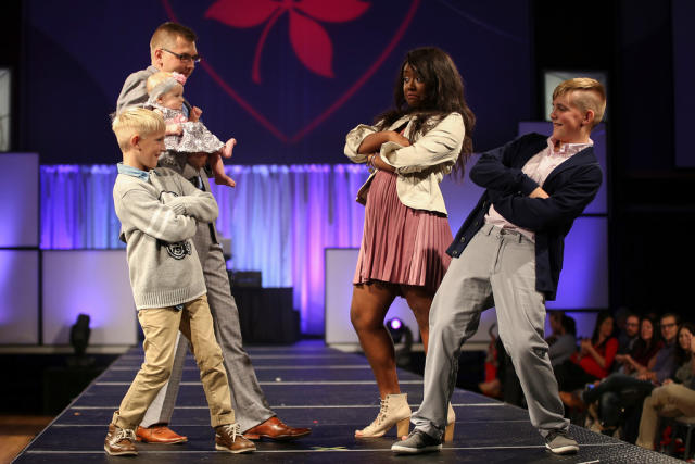 Reid, his brother Rudy and baby sister Amelia model with student models at the 2016 Fashion Show.