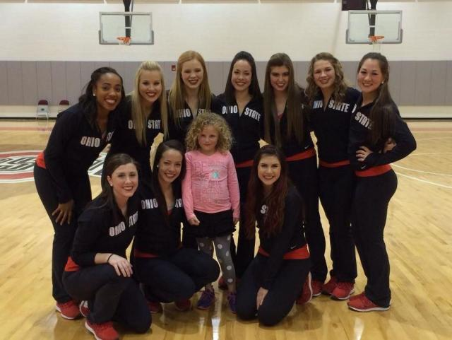 BuckeyeThon Kid Hailey hangs out with the Ohio State Dance Team.